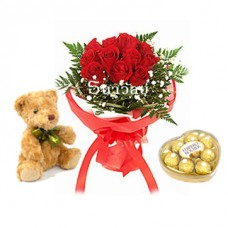 Bouquet of 12 short stemmed red roses with teddy bear and chocolates