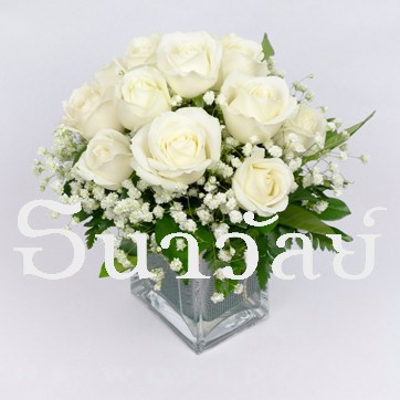 12 white roses in a glass vase