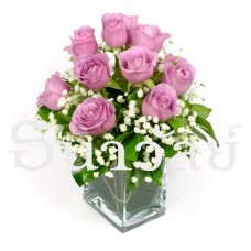 12 violet roses in a glass vase
