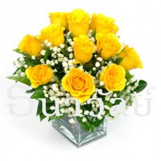 12 yellow rose in a glass vase